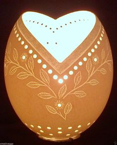 A hand carved ostrich egg lamp shade. Ideal gift for anyone special. Original egg art. Made in South Africa. Signed by artist. Special price: will only be available during this listing.