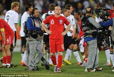 Wayne Rooney (centre) feels the pain as England crash out of the World Cup