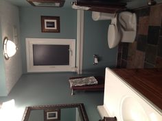slate floor and shower with the color sea star by benjamin moore kitchen walls