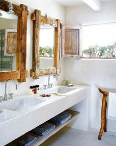 beautiful bathroom. those wood mirrors and white sink are a perfect combo