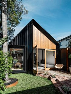 This modern house addition features a pitched roof, and is covered in a combination of standing seam black metal siding, Silvertop Ash shiplap siding, and weatherboard. Architecture Design, Architecture Renovation, Australian Architecture, Sustainable Architecture, Residential Architecture, Contemporary Architecture, Architectural Design Studio, Contemporary Houses, Pavilion Architecture