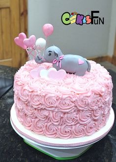 Elephant baby shower cake with pink buttercream rosettes