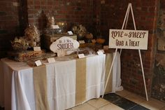 LOVE this dessert table & signs...really like the rustic look.
