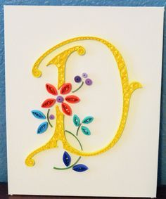 """Letter """"D"""" quilling on canvas"""