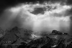 When the light rains by isabella_tabacchi  sky mountains travel light clouds italy lights black and white snow mountain alps dolomites tn dolom