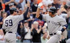 New York Yankees' Alex Rodriguez, right, celebrates his three-run home run with third base coach Rob Thomson (59) during the first inning of a game against the Baltimore Orioles on May 8, 2009 in Baltimore. It was Rodriguez's first game back from hip surgery. (Rob Carr/AP)