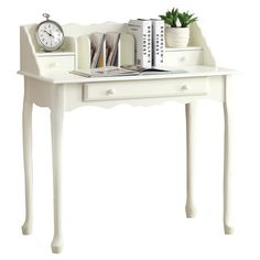Add a classic touch to your home office or library with this elegant desk, showcasing scalloped trim and a crisp white finish.  Prod...