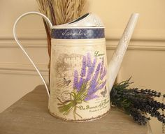Vintage watering can with lavender.