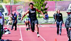 Isaac Gonzales represents Taos at the Marilyn Sepulveda Meet of Champions, Monday (April 14) in Albuquerque. Gonzales finished fifth in the triple jump, pictured, and third in the 400-meter dash. Photo courtesy Allan Lemley