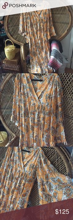 70s vintage paisley angel sleeve maxi dress Spell Reminds me of my favorite Spell Gypsy prints from earlier drops. Awesome vintage condition. Best on L or XL but can work on medium belted. Feels like poly. tags: free people Spell Gypsy Collective cleobella faithfull the Brand vintage retro 70s psychedelic groovy Austin powers Charlie's angels Indian gauze Vintage Dresses Maxi