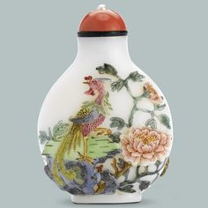ENAMEL ON MOLDED AND CARVED WHITE GLASS SNUFF BOTTLE