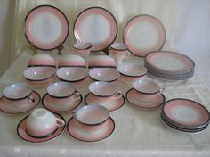 This is a lovely set of Hazel Atlas Informal. The set includes:  10 dinner plates - 9  7 cereal bowls - 4-7/8  11 saucers - 5-58  6 cups -