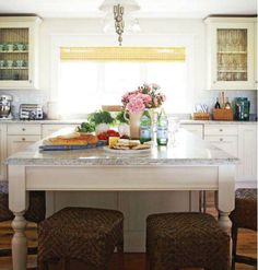 a different way to do a large island: perpendicular to cabinets, not parallel and seating is around one end - not all on one side...