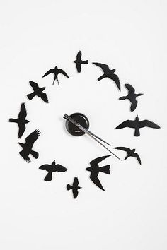 could totes make own of these. just need clock. DIY Bird Wall Clock. #urban