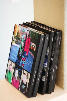 family yearbooks... So the family pics aren't just stuck on the computer. Love love love this idea.