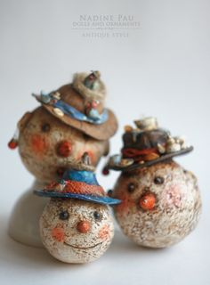 """Snowmen"" by Nadine Pau. Christmas ornaments. Papier mache, oil patina varnish. Sold #christmasornaments #nadinepau"