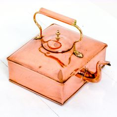 A Victorian square copper kettle. http://witchantiques.com/victorian-square-copper-kettle.html