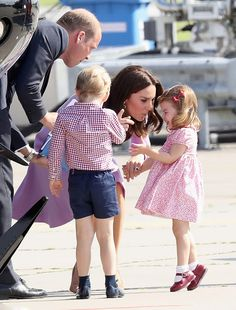 The Duchess of Cambridge appeared to be giving her daughter a talking to after Princess Charlotte erupted into a tantrum on the final day of their five-day royal tour that has taken them to Warsaw, Berlin, Heidelberg and their final stop, Hamburg, while Prince William, Duke of Cambridge and Prince George looks on.