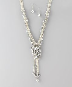 Accessorize with effortless elegance. This chic set features a stunning silver tone, while luminescent pearls add glam to an ensemble.