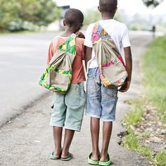 When you buy a No.41 backpack, you are also providing a backpack for a primary school student in Rwanda. Backpacks are handmade by our new partnering women's co-op in Gisenyi, Rwanda. All bags are made with African iktenge fabric and standard Rwandan school uniform material.