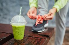 Photo about Green detox smoothie cup and woman lacing running shoes before workout on rainy day. Fitness and healthy lifestyle concept. Image of nutrition, runner, girl - 40004640 Best Post Workout, Good Pre Workout, Hard Workout, Pre Workout Shake, Detox Kur, Protein Snacks, Healthy Snacks, Stay Healthy, Smoothie Detox