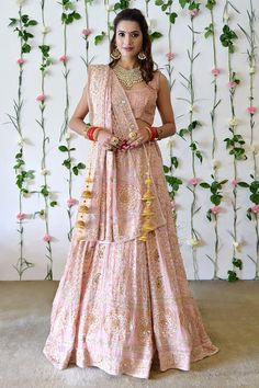 From our Bridal Heritage Collection, this timeless nude peach outfit presenting a beautiful fusion of heritage thread crafts Chikankari, beads, sequin and crystal hand embroidery. The lehenga and dupattas are crafted in pure georgette with intric Gold Lehenga Bridal, Pink Lehenga, Lehenga Wedding, Indian Lehenga, Lehenga Skirt, Lehenga Style, Designer Dress For Men, Designer Dresses, Peach Clothes
