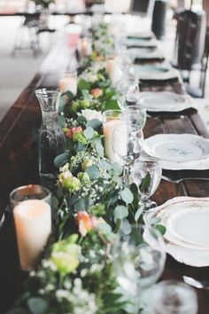 Eucalyptus, rose & baby's breath runners contrast beautifully with the walnut tables. Photography: Joanna Day Photography - www.joannadayphotography.com