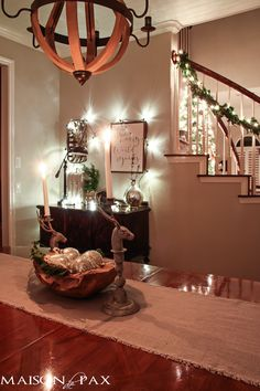 """holiday decorating: globe christmas lights above buffet, lighted garland on stairs~I love the picture saying """"The weary world rejoicing"""""""