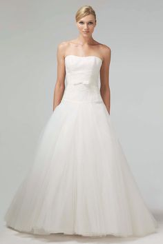 Ivory silk organza strapless drop waist ball gown, tulle skirt with bows down back and lace accent at waist