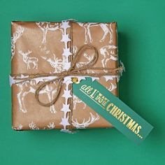 Brown paper and white stag print? Winner! Naturally. #green #stag #wrap #deer #wild #brownpaper #kraft #christmas #wrap