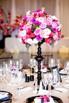 black-wedding-topiary using dollar store items about $3.00 per centerpiece plus the cost of flowers