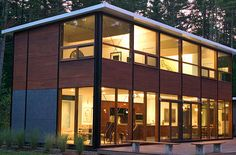 FlatPak is a pre-engineered modular home design system. Very green.