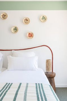 Bands of yellow, orange, emerald and pine-green paint have been created just beneath the rooms' ceilings, matching the stripey throws that have been laid across the beds. Blue Striped Curtains, Striped Chair, Architectural Digest, Juan Les Pins, Open Hotel, Wooden Side Table, Wicker Chairs, Hotel Interiors, Vacation