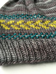 Sprouted Hat by Sara Gresbach | malabrigo Rastita in Plomo and Silky in Manzanilla Olive and Teal Feather