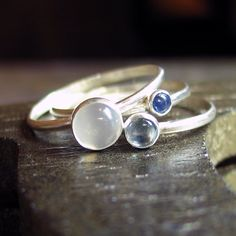 Sterling Silver Stacking Rings with moonstone, sapphire and swiss blue topaz September - Sky Blue Dreaming.from Lavender Cottage on Etsy (love how simply elegant they are, without a lot of artwork around them. The focus is just on the stones) Silver Rings With Stones, Silver Stacking Rings, Topas, Himmelblau, Or Rose, Watch Bands, Sterling Silver Jewelry, Diamond Cuts, Jewelry Rings