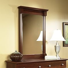 Attaches to  Dresser 411830 .  Select Cherry finish.