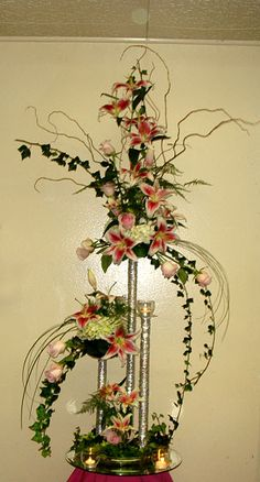 Lilies, roses and orchids centerpiece