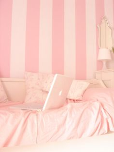 This monochromatic pink room provides rose, baby, and light pinks. The bright hue call for attention and the light values increase apparent size. The high intensity also appeas closer than they really are.