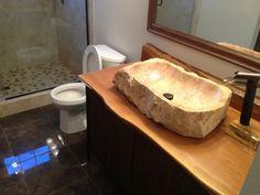 diseño de lavabo rústico de piedra natural