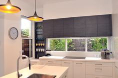 Like the grey and white mix of cupboards and the garden behind the window splash…