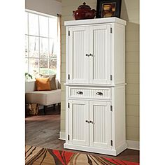 @Overstock - This Nantucket Pantry is constructed of hardwood and engineered woods in a Sanded and Distressed White Finish. This furniture's features include storage drawer, two cabinet doors with two adjustable shelves and antique brushed nickel hardware.http://www.overstock.com/Home-Garden/Nantucket-White-Distressed-Finish-Pantry/6626617/product.html?CID=214117 $479.43