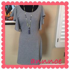 Cascade sleeve tunic dress THIS IS BOTH CUTE AND COMFORTABLE!!  It is a comfortable material of poly/cotton/spandex.  It feels like a tshirt dress.  It can be dressed up or down.  It also hangs well on the body and is not tight at the belly area. LONG ENOUGH to be a mini dress in warm weather and a tunic with leggings and booties in cold weather!! THIS RUNS SMALL!  MEDIUM will fit a 2,4 and LARGE will fit a 6,8 in this style. Tulle Dresses Mini
