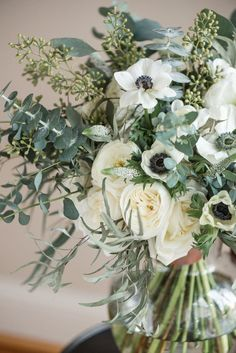 Courtney Inghram Events floral design photographed by Audrey Rose Photography at Early Mountain Vineyards in Virginia. White wedding bouquet for bride with anemones, garden roses, veronica, seeded eucalyptus, feather eucalyptus, gunni eucalyptus and white roses for a winery wedding. Organic wedding with anemones and seeded eucalyptus. Wedding flowers with eucalyptus greenery and white flowers. Winter vineyard wedding. Bridal bouquet for winery wedding with garden-inspired natural textures