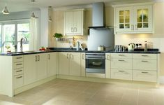 Wickes fitted kitchens: Marlow. These units with thick oak top and cup/finger pulls, belfast sink