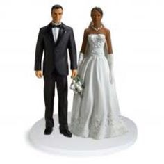 Interracial cake topper... How appropriate.