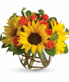 Sunny Sunflower Bouquet Yellow Sunflowers and Orange Roses steal the show in this simple arrangement. Also featured: green bupleurum, salal leaves and a curly willow inside the glass bubble bowl. #CrouchFlorist #FallFlowers #Autumn #seasons