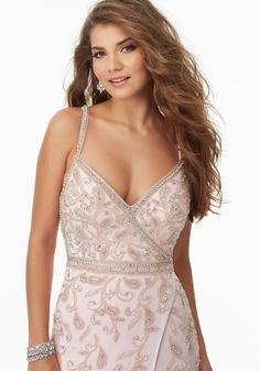 Sexy Prom Dress Featuring a Deep-V Neckline and Intricate Caviar Beading on Net. Open Back with Zipper Closure. Colors Available: White, Pink.