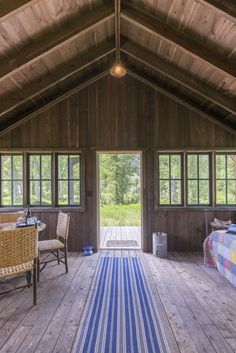 The screened-in porch in Grayling Canvas Cabin at The Ranch at Rock Creek. The glamping cabins are distinctly furnished in a rustic camp style, featuring private baths, luxurious bedding and the murmur of the creek running just outside your front door.
