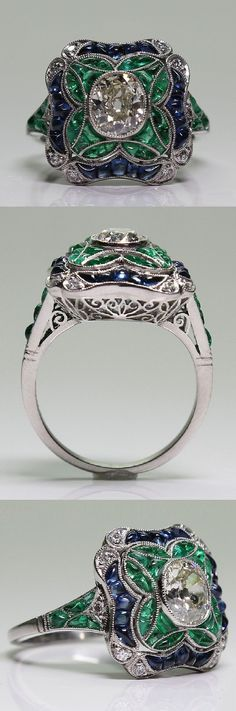 An Art Deco platinum, diamond, sapphire and emerald ring, 1920-35.  #ArtDeco   #ring