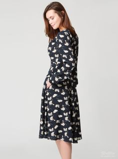 BLACKFRIDAY offer is not valid on this item.  This dress is inspired by '30s silhouettes. It is cut from floral crep.   Navi, milk and brown crepe  Button fastenings through front  Pockets  Dry clean  Fabric made in Italy     Composition: 100%viscose.  Care:dry clean, iron on a medium heat.    The length:11143,7cminch  The length of the sleeve:64,525,39cminch  ...